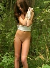 Provocative role play with a cute teen girl tied up to a tree and waiting for someone to fuck her