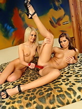Two hot babes w/ a strap-on dildo pussy licking lesbian action