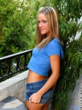 Tempting mckenzee in denim skirt showing nice tight cool panty on balcony