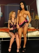 Kinky secretaries getting out of control putting in action black strap-on