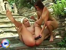 Two gorgeous young lesbian kittens pull out an arsenal of sex toys to have some fun outdoors