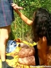 Hot young bitch sucking a hard dick and showing her tight teen body in the woods