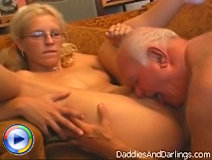 This elderly dick will just lie on bed while his attractive young girl will lick his erected big shaft