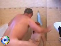 Hot young redhead gets fucked by an older guy in the bathroom