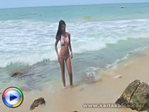 Karla almost sheds off her whole bikini