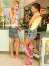 These two beautiful young lesbian kittens have turned the kitchen into a real sexual battlefield